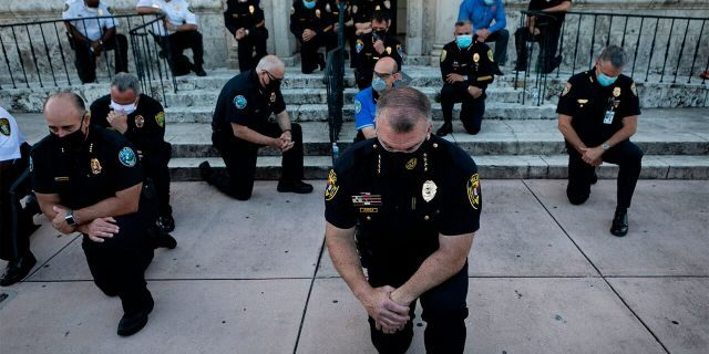 Police Kneel In Solidarity With Protesters Before Going Back To Beating The Shit Out Of Them